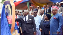 L-R: Lagos State Governor, Mr. Akinwunmi Ambode, unveiling the new Lagos Neighbourhood Safety Corps (LNSC) logo while the Commissioner for Special Duties & Inter-Governmental Relations, Mr, Oluseye Oladejo; Deputy Governor, Dr. (Mrs) Oluranti Adebule and Speaker, Lagos State House of Assembly, Rt. Hon. Mudashiru Obasa, watch during the inauguration of the Corp at the Agege Mini Stadium, Lagos, on Monday, March 27, 2017.