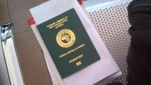 A Nigerian Passport and Visa used to illustrate the story {Photo:Naij.com]