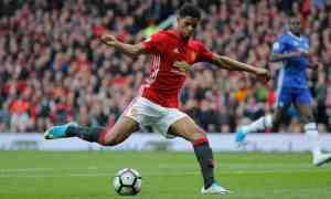Manchester United's Marcus Rashford shoots to score his side's first goal. Photograph: Tom Jenkins for the Guardian