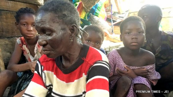 One of the residents of Otodogbame with kids after the demolition