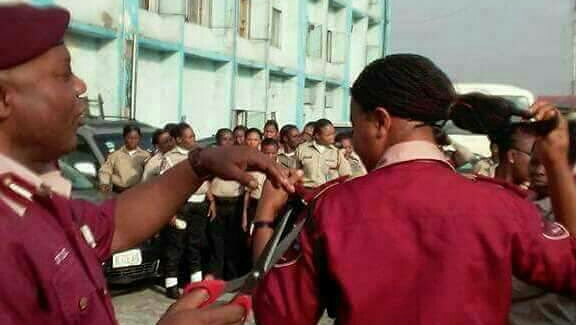 Rivers FRSC sector commander, Ayodele Kumapayi cutting female officers hair