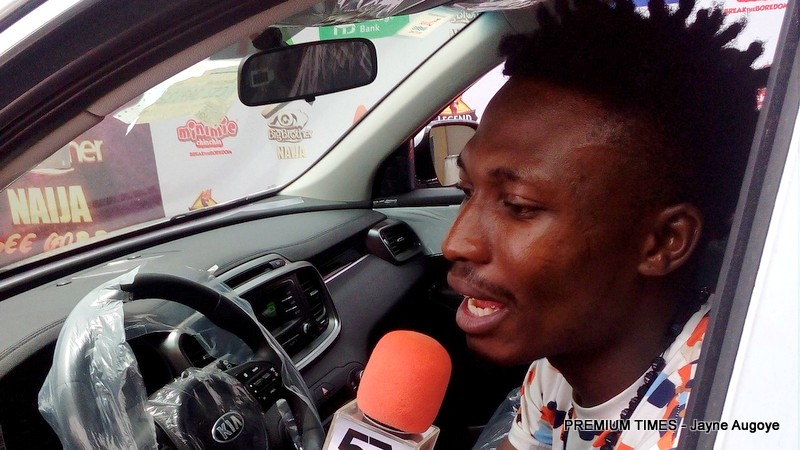 Big Brother winner, Efe Ejeba in his brand new Kia SUV
