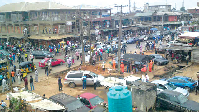 A street in Ikorodu town, Lagos [Photo Credit: The Guardian]