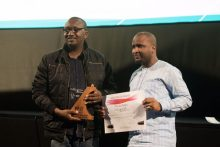Izu Ojukwu, the Director of 76, and Moses Babatope, who represented the director of the Wedding Party displaying their awards.