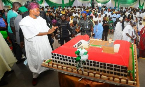 Celebrant and Governor State of Osun Rauf Aregbesola with his 60th Birthday Cake, during a Colloquium,title:Good Governance and Challenges of Leadership in his honour, at De Distinguished Event Centre, Osogbo on Thursday 25-05-2017