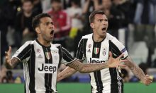 Goalscorers Mario Mandzukic and Dani Alves celebrate. Photograph: Luca Bruno/AP