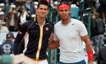 epa03671120 Novak Djokovic (L) of Serbia and Rafael Nadal of Spain pose before their final match at the Monte-Carlo Rolex Masters tournament in Roquebrune Cap Martin, France, 21 April 2013  EPA/SEBASTIEN NOGIER