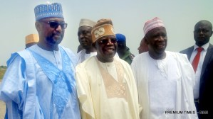 FROM LEFT: Gov. Abubakar Bello of Niger; APC chieftain, Asiwaju Bola Tinubu; and Gov. Abdullahi Ganduje of Kano State, at the Minna Airport, for the wedding of Halima Babangida, second daughter and last child of Gen. Ibrahim Babangida's family, to Alhaji Auwal Abdullahi, a businessman who holds the traditional title of Sarkin Sudan Gombe, on Friday (11/5/17). 02611/12/5/2017/ Ismail Abdulaziz/BJO/NAN