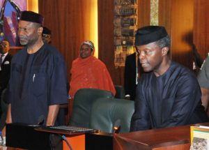 Acting President Yemi Osinbajo and the Minister of Budget and National Planning, Sen. Udom Udo Udoma, at the National Economic Council Meeting in Abuja on Thursday (24/5/17). 02799/25/5/2017/Callistus Ewelike/BJO/NAN