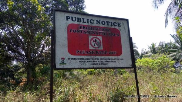 A signboard warning of potential hazard to humans at Goi, Ogoniland