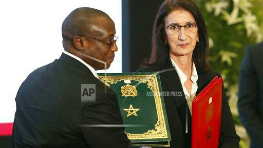 Moroccan Director General of the National Board of Hydrocarbons and Mines, Mrs Amina Benkhadra (right) shakes hand to Maikanti Kacalla Baru Chairman and CEO of the Nigerian National Oil Company, after signing of documents of Cooperation agreement of the Nigeria-Moroccan gas pipeline project that will connect the two nations as well as some other African countries to Europe at the king Palace in Rabat, Morocco, Monday May 15, 2017. (AP Photo/Abdeljalil Bounhar)
