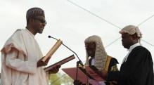 Buhari taking oath before judge [Photo: News Time]