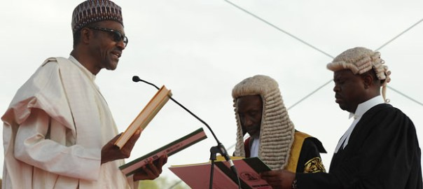 Buhari taking oath before judge [Photo: News Time]