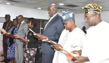 L-R:  Mr. Hakeem Olaogun Dickson as Director General of Lagos State Safety Commission, Mrs. Jokotola Ojosipe-Ogundimu as member of Audit Service Commission, Mr. Ayo Adebusoye, Mrs. Iyabo Elizabeth Ladipo and Mr. Bolaji Miftah Are as members of Public Procurement Agency; Prof. Gabriel Olatunde Babawale and Noah Olanrewaju Lawal-Jinadu as members of Lagos State Independent Electoral Commission (LASIEC), taking Oath of Office, being conducted by the Director, Legislative Drafting, Ministry of Justice, Mrs. Yejide Kolawole before Governor Akinwunmi Ambode at the Lagos House, Ikeja, on Monday, June 19, 2017.