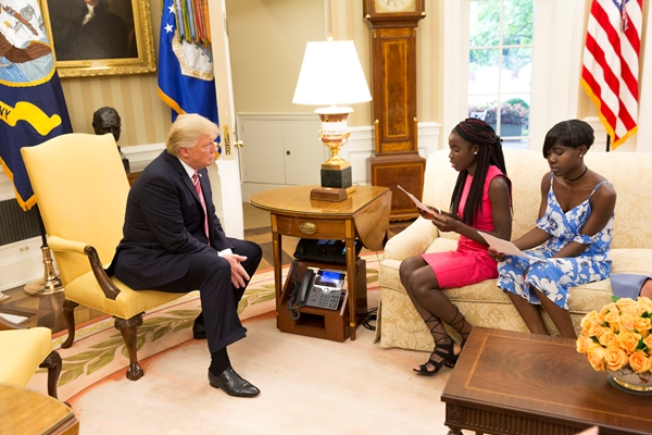 President Donald J. Trump and Presidential Assistant Ivanka Trump welcome Chibok schoolgirls Joy Bishara and Lydia Pogu, who along with more than 270 classmates were kidnapped by the Book Haram militants in April 2014, and recently released, visit the Oval Office at the White House,Tuesday, June 27, 2017,  in Washington, D.C. (Official White House Photo by Claire Barnett)