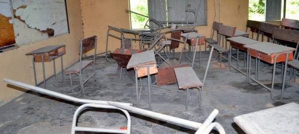 One of the classrooms with damaged desks