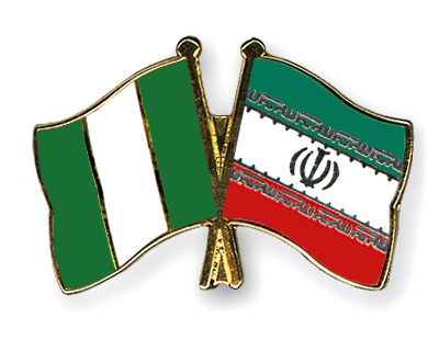 Flags of Nigeria and Iran [Photo: Crossed Flag Pins]