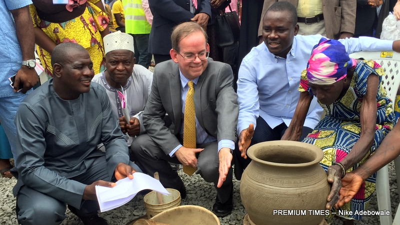 The Charge 'D'Affairs U.S mission Nigeria, David Young and the executive chairman of bwari area council, Musa Dikko during the commissioning of the Jikoko health clinic/flag off of the Bwari area council immunization campaign