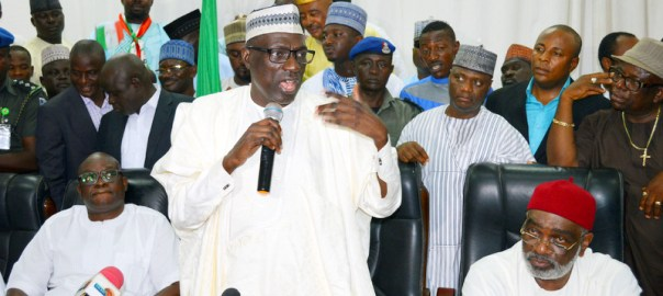Chairman, PDP Caretaker Committee, Sen Ahmed Makarfi, speaking to party faithful, at the PDP Secretariat after the supreme court upheld his position as the authentic leader of the party in Abuja on Wednesday (12/7/17). With him are Gov. Ayo Fayose of Ekiti State (L) and former Special Adviser to the President on Inter-party Affairs, Sen Ben Obi  03482/12/7/2017/Ernest Okorie/ICE/NAN