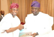 Lagos State Governor, Mr. Akinwunmi Ambode (right), with his Osun State counterpart, Ogbeni Rauf Aregbesola, exchanging State plaque and souvenir during Governor Ambode's courtesy visit to Osun State Government House, Osogbo, on Thursday, July 20, 2017.