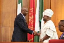 Senate President Bukola Saraki welcomes Ademola Adeleke after he was sworn in.