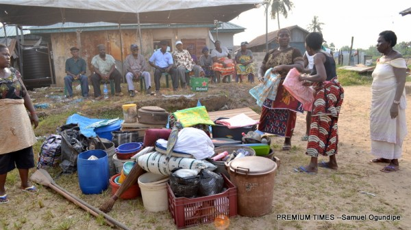 relatives of Golubini Okoromadu gathered outside her house in Oporoza village to share out her properties