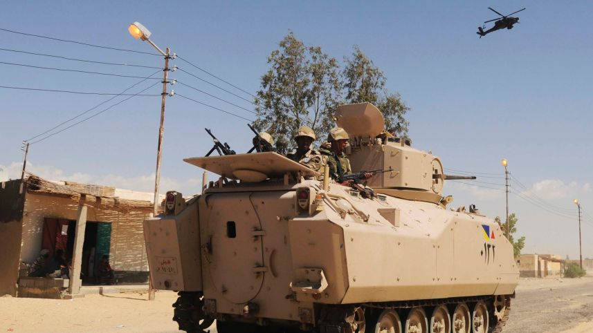 Egyptian Army soldiers patrol in northern Sinai, Egypt, Tuesday, May 21, 2013. Credit: AP