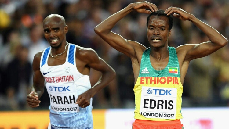 """LONDON, ENGLAND - AUGUST 12:  Muktar Edris of Ethiopia does the """"Mobot"""" as Mohamed Farah of Great Britain looks on after crossing the finishline in the Men's 5000 Metres final during day nine of the 16th IAAF World Athletics Championships London 2017 at The London Stadium on August 12, 2017 in London, United Kingdom.  (Photo by Shaun Botterill/Getty Images)"""