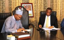 Secretary to the State Government, Lagos State, Mr. Tunji Bello (right) and Permanent Secretary, State House Abuja, Mr. Jalal Arabi (left), signing documents during the official hand-over of the Presidential Lodge, Marina to the Lagos State Government, on Thursday, August 17, 2017.