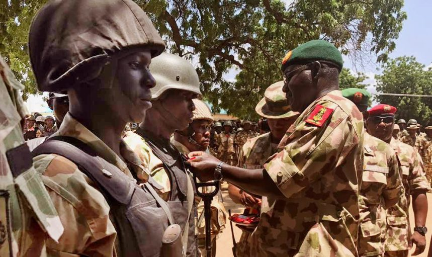 Chief of Army Staff, Lt.-Gen. Tukur Buratai decorating 65 soldiers with medals for their gallantry in the fight against Boko Haram insurgents at Bama in Borno on Wednesday (10/817). 04172/11/8/2017/Rabiu Sani/BJO/NAN