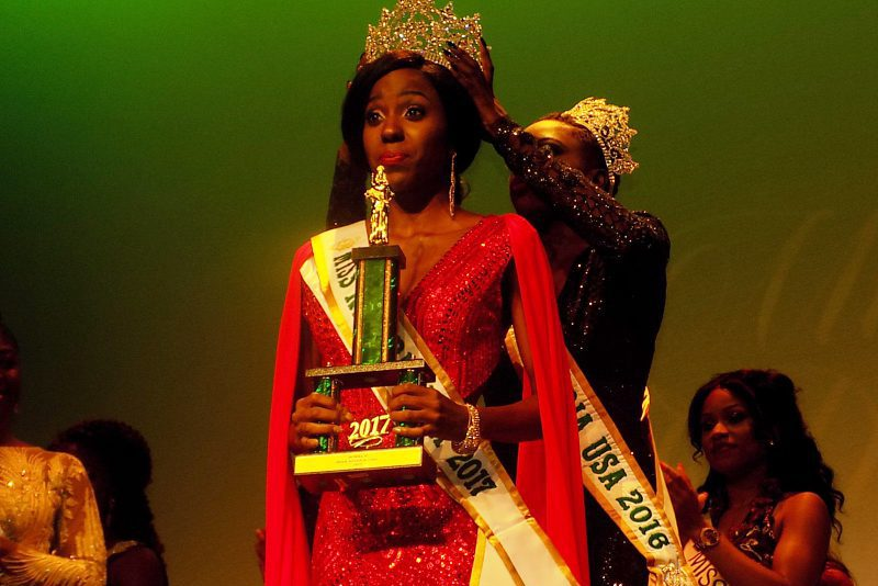 Miss Nigeria U.S. 2017, Idara Inokon, being crowned by her predecessor, Miss Lola Adeoye, during  the pageant on Saturday night in New York.(13/8/17). 04238/13/8/2017/ Prudence/OTU/NAN