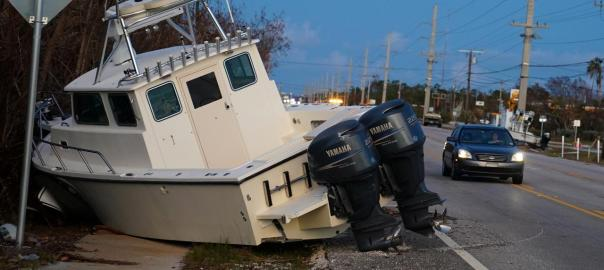 A boat lays across US 1 after Hurricane Irma in Big Pine Key, Florida, U.S., September 14, 2017. REUTERS/Carlo Allegri