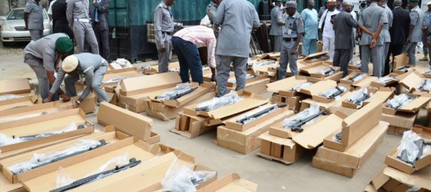 Officials of Nigerian Customs Service sorting some of the 470 pump action rifles smuggled into the country, which were seized 10 days after a similar seizure from Turkey, in Lagos on Thursday (21/9/17). 05078/21/9/2017/Wasiu Zubair/TA/BJO/NAN