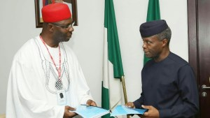 Chairman, Senate Committee on Anti-Corruption and Financial Crimes, Sen Chukwuka Utazi (l) presenting the Report of the Committee to ; Vice-president Yemi Osinbajo at the Presidential Villa in Abuja on Wednesday (20/9/17).  05048/20/9/2017/ ICE/NAN