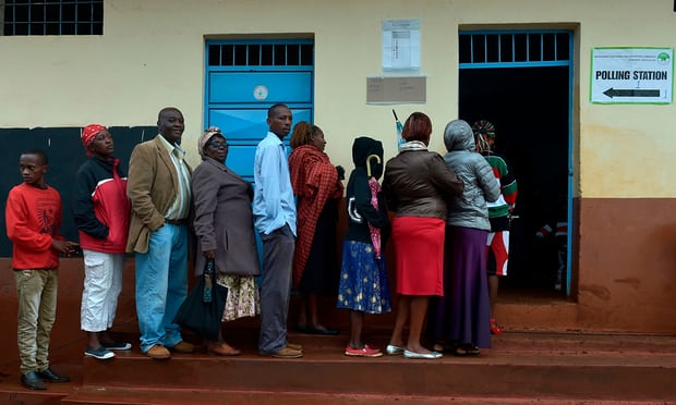 Voters queue at a polling station at Mutomo primary school in Kiambu. Photograph: Simon Maina/AFP/Getty Images [Photo Source: Guardian UK]
