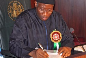 Goodluck Jonathan signing