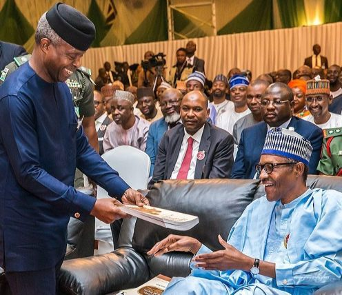 VP Osinbajo presented the Mid-Team Scorecard on the President Muhammadu Buhari Administration in a book to the President after the unveiling on stage during the book presentation at the old Banquet hall, Presidential Villa. 16th Nov. 2017. [Credit: novoisioro]