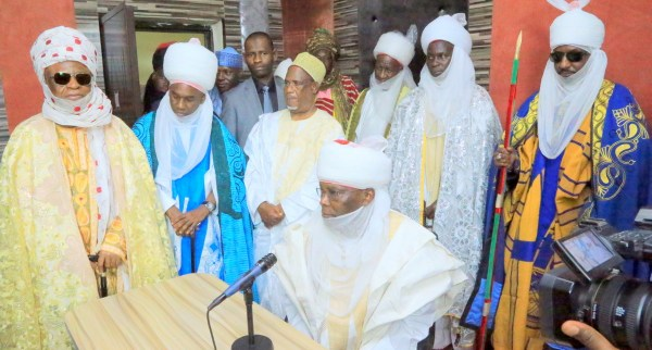 Former Vice President and Waziri Adamawa, Atiku Abubakar (sitting) while standing from right Emir of Kano, Alh. Muhammadu Sanusi II; Emir of Shelleng, Abdullahi Isa Dasong; Emir of Mubi, Dr Abubakar Isa Ahmadu; Emir of Gombe, Alh. Abubakar Shehu Abubakar (5th right) and Lamido Adamawa and founder of Pulaaku Station, Dr Barkindo Mustapha at the formal commissioning of the station, in Yola, Adamawa State, at the weekend.