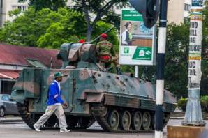 Military blocks road into parliament in Harare Wednesday morning following overnight takeover of power [Photo Credit: BBC]
