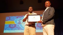Editor-in-Chief, Musikilu Mojeed and Emmanuel Mayah receiving the award