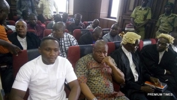 From left in front row, David Nwawuisi dressed in white with Benjamin Madubugwu, sitting next to him and two other lawyers: while Chidebere Onwudiewe wears a white stripes native attire, behind the two co-defendants.
