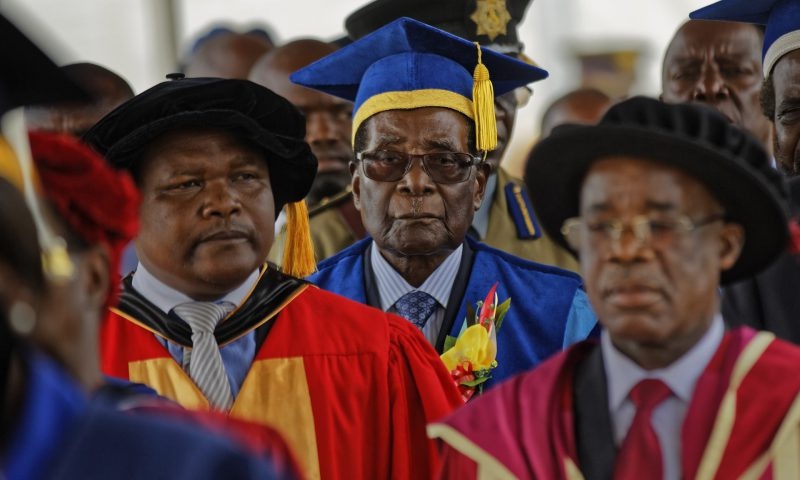 Robert Mugabe arrives to preside over a student graduation ceremony at Zimbabwe Open University on the outskirts of Harare. Photograph: Ben Curtis/AP