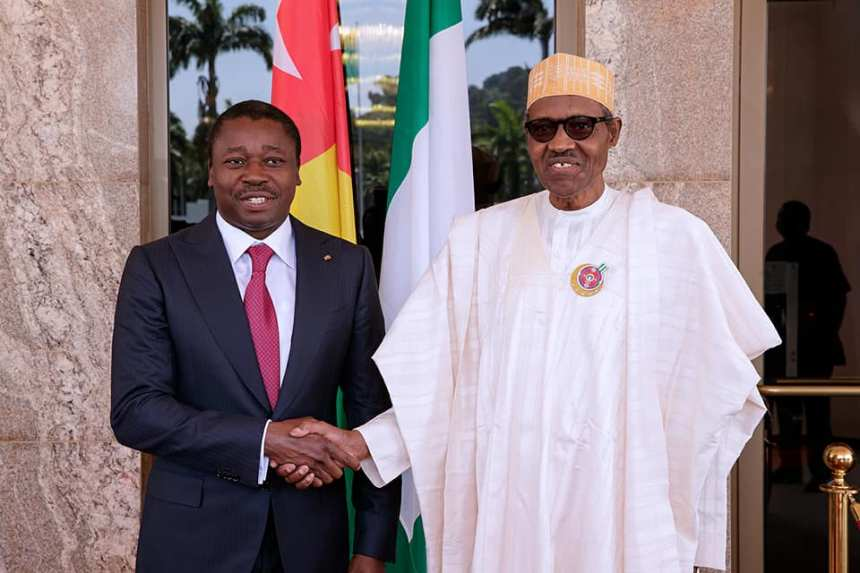 President Muhammadu Buhari and the President of Togo, Faure Gnassingbe shaking hands. [Photo credit: Daily Post Nigeria]