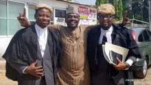 Yushau Shuaib with his lawyers at National Industrial Court