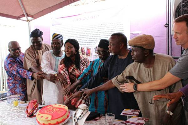 Photograph cutting the cake. from L-R. Barrister Dapo Olowu, Prof/ Prof Dele and Peju Layiwola, Prof Bruce Onobrakpeya, Mr. Kolade Oshinowo, Prof. Bayo Lawal, US Cultural Attache, Kevin Krapf