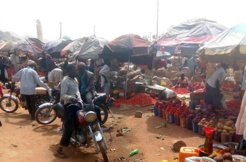 Some traders at Bwari setting up their wares by the roadside after the market was burnt down on Christmas Day.