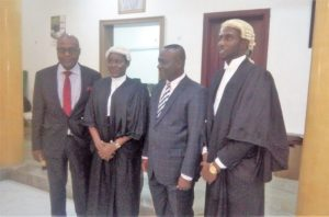 Senior Special Assistant to the President on National Assembly Matters, Ita Enang (2nd from Right) with the Dean, Faculty of Law, University of Uyo, Imo Udofa at the reception in honour of two law graduates of the University, Kuseme Iseh (2nd left) and Inyene John (right) in Abuja on Wednesday.