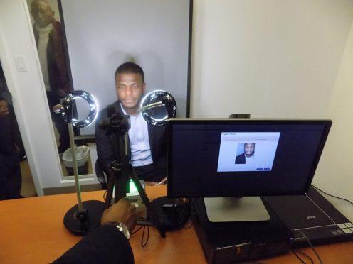 A Nigerian visa applicant going through the biometric process. [Photo credit: PM News]
