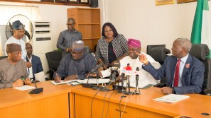 Hon. Minister of Power, Works & Housing, Mr Babatunde Fashola,SAN(right),Minister of State, Hon.Mustapha Baba Shehuri(2nd left) ,Governor of Lagos State, Mr Akinwunmi Ambode(2nd right) and Secretary to the Lagos State Government, Mr Tunji Bello (left) during the Formal Handing Over of the Presidential Lodge, Marina, Lagos, to the Government of Lagos State at the Ministry of Power, Works & Housing Headquarters, Mabushi, Abuja, on Tuesday 12th, December 2017.