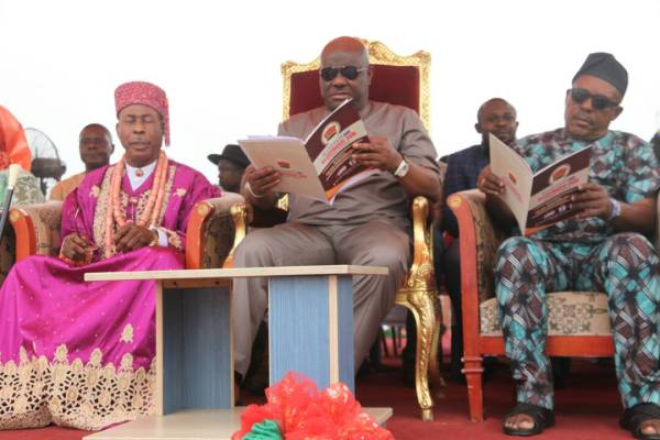 Rivers State Governor, Nyesom Ezenwo Wike (m) , PDP National Chairman, Prince Uche Secondus (r) andEze Oha Apara, Eze C. A. Worlu-Wododuring the Civic Reception organised in his honour by the Apara Kingdom on Saturday in Port Harcourt
